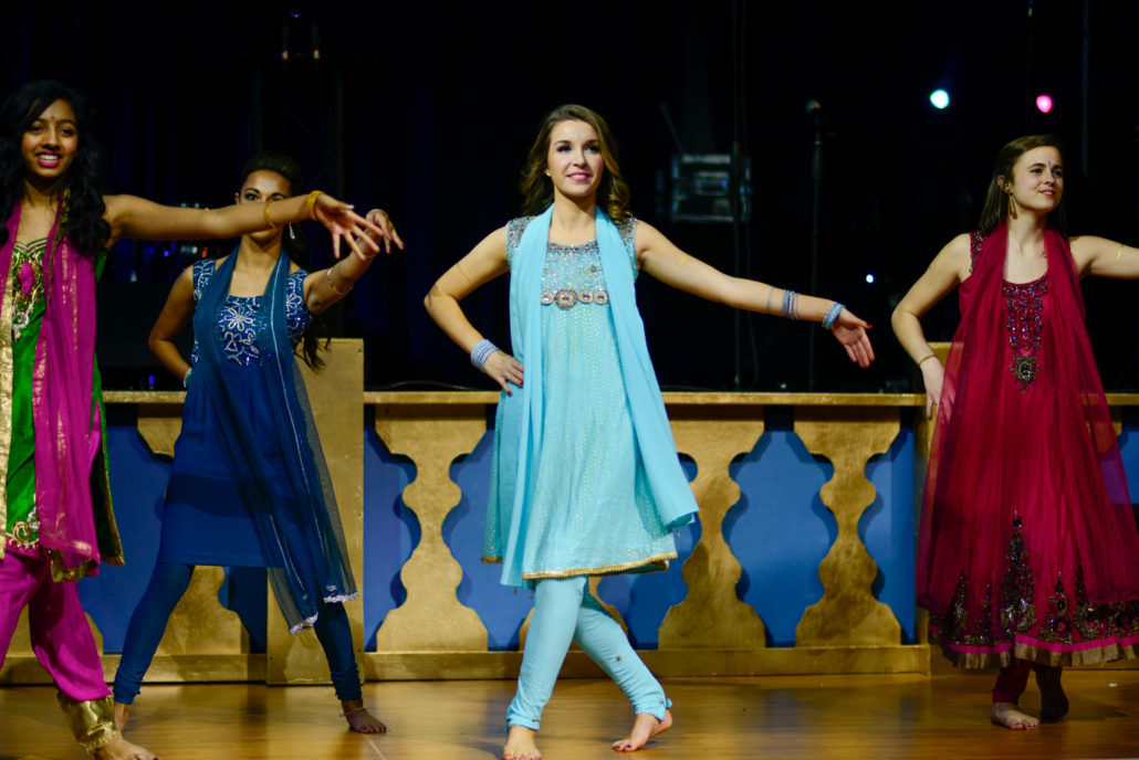 Dancers in flowing dresses and scarves perform for 2015 Midwinter Ball A Passage to India