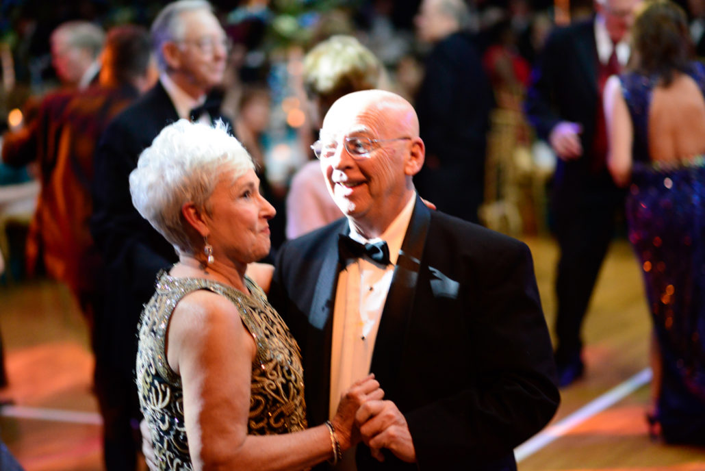 A couple dances in a crowd at Midwinter Ball 2015