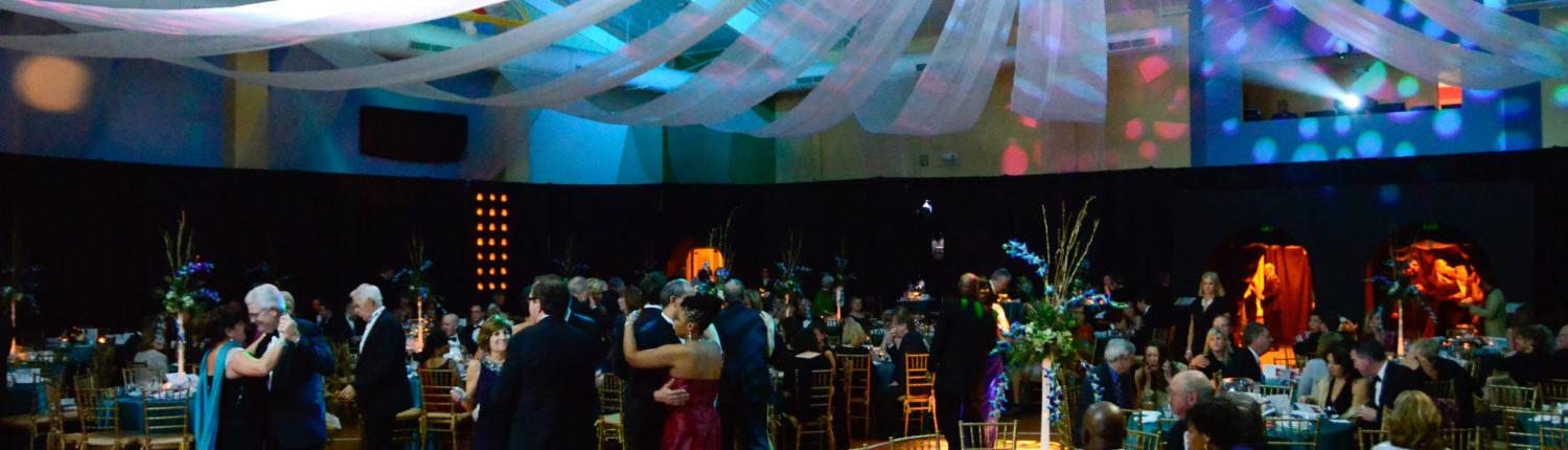 Fabric in shades of blue drapes from the ceiling over the dance floor at A Passage to India Midwinter Ball