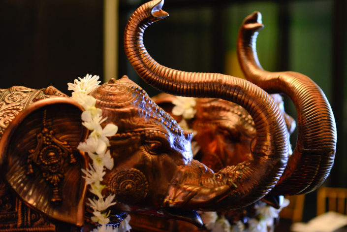 Elephant statues with flower chains, part of the decor for Midwinter Ball A Passage to India